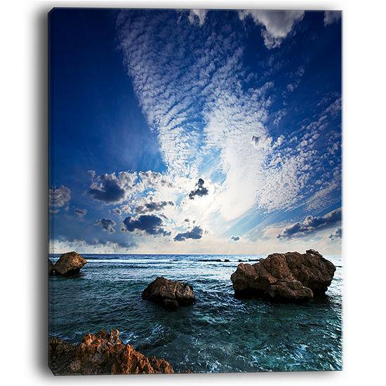 Designart Rocky Beach With White Clouds Canvas Art