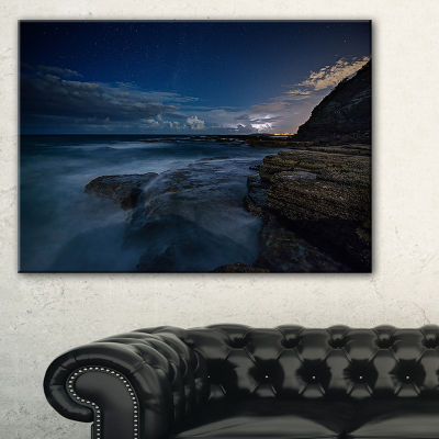 Designart Rocky Blue Ocean At Nighttime Canvas Art