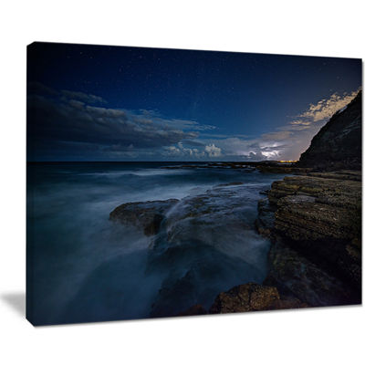 Designart Rocky Blue Ocean At Nighttime Canvas Art