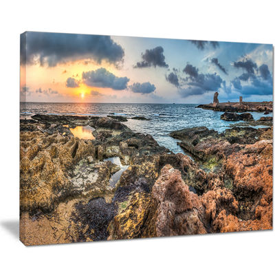 Designart Rocky Blue Seashore Sunset Canvas Art