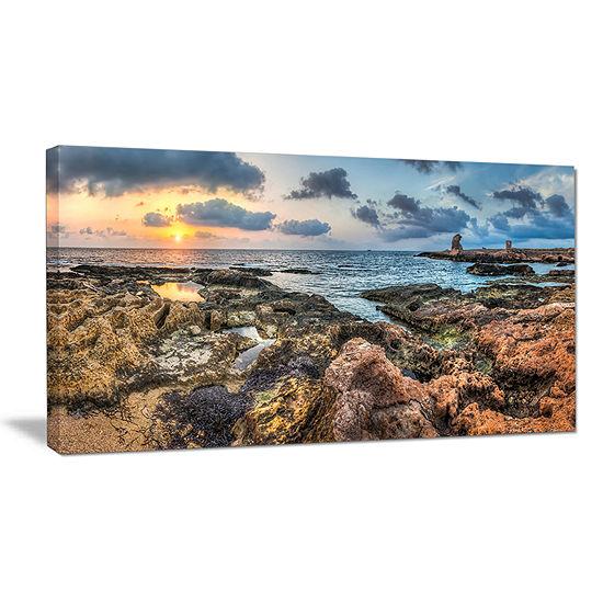 Designart Rocky Blue Seashore Sunset Canvas Art