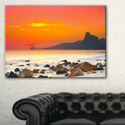 Designart Rocky Seashore Under Colorful Sky Canvas Art