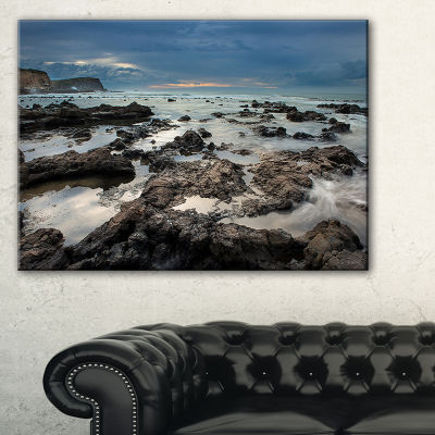 Designart Rocky Seashore With Blue Sky Over Canvas Art