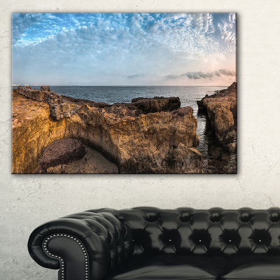 Designart Rough Rocky Coast Under Blue Sky Canvas Art