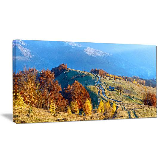 Designart Rural Road On Autumn Mountains Canvas Art