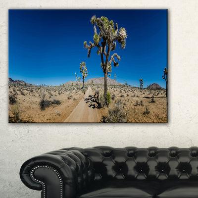 Designart Sandy Desert Road Panorama Canvas Art