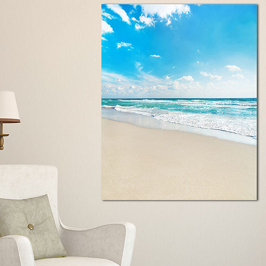 Designart Sea Beach Against Wave Foaming Canvas Art