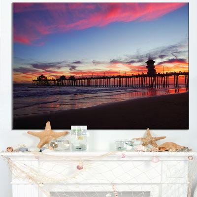 Designart Sea Bridge In California With Red Clouds Canvas Art