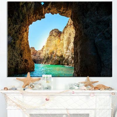 Designart Sea Through Rocky Cave Portugal Canvas Art