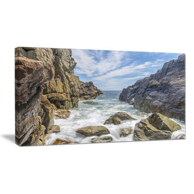 Designart Sea Waves Hitting Rocky Shore Canvas Art