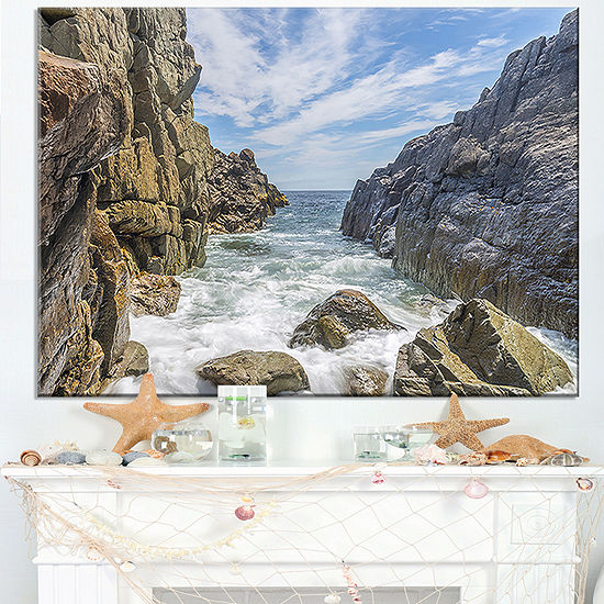 Designart Sea Waves Hitting Rocky Shore Canvas Art