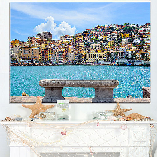 Designart Seafront Bench In Port Santo Stefano Canvas Art