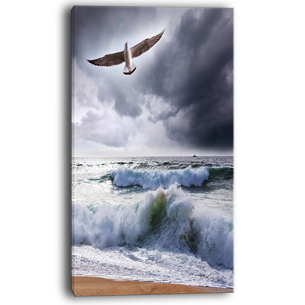 Designart Large Seagull Over Stormy Waves Canvas Art