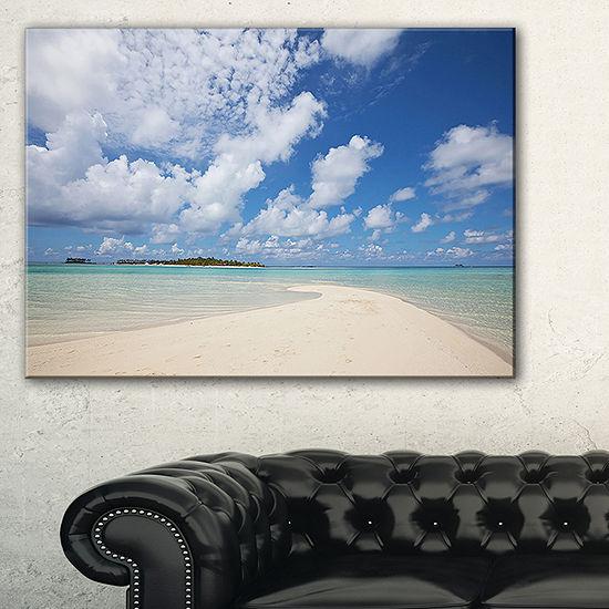 Designart Serene Maldives Beach Under Clouds Canvas Art