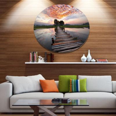 Design Art Wooden Bridge under Dramatic Sky Seashore Metal Circle Wall Art