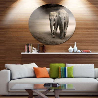 Designart Elephant Pair in Motion Ultra Glossy Animal Oversized Metal Circle Wall Art