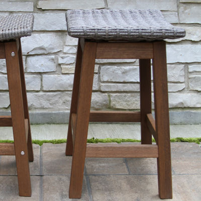 Outdoor Interiors Counter Height Round Composite Table With Grey Wicker Saddle Stools 3-pc. Patio Bar Set