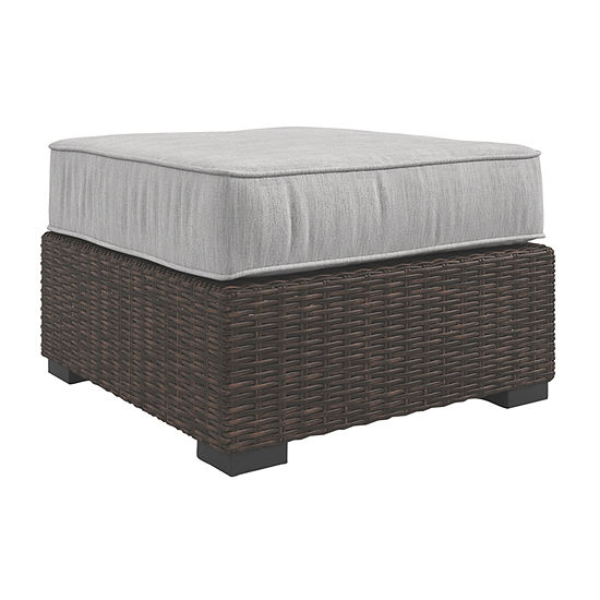Outdoor by Ashley® Alta Grande Patio Ottoman with Cushion