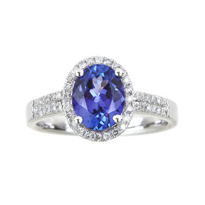 LIMITED QUANTITIES  Oval Genuine Tanzanite and 1/4 CT. T.W. Diamond Ring