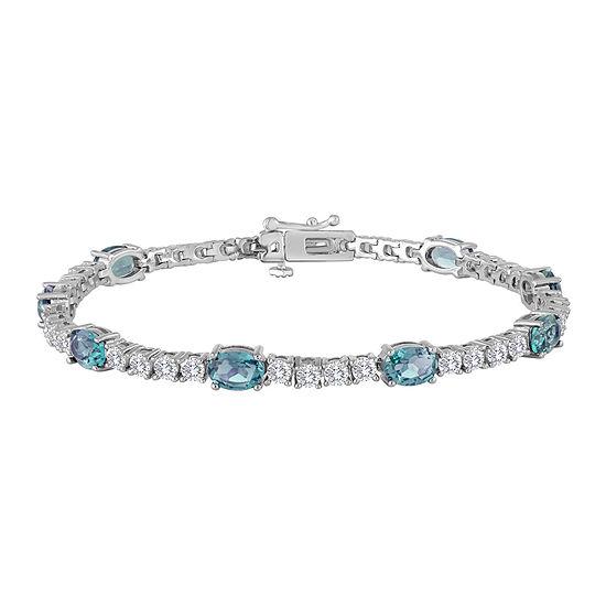 Sterling Silver Over Brass Genuine Blue Topaz and Cubic Zirconia Tennis Bracelet