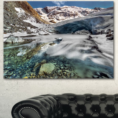 Designart Cave In Rugged Rocky Setting LandscapeCanvas Art Print - 3 Panels