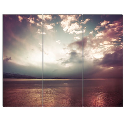 Designart Dark Sunset With Dramatic Sky Large Seashore Canvas Art Print - 3 Panels