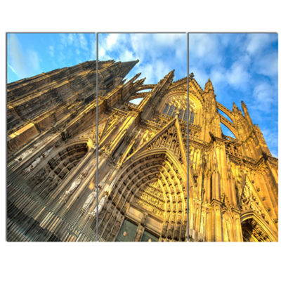 Designart Facade Of Dom Church With Blue Sky LargeCityscape Art Print On Canvas - 3 Panels
