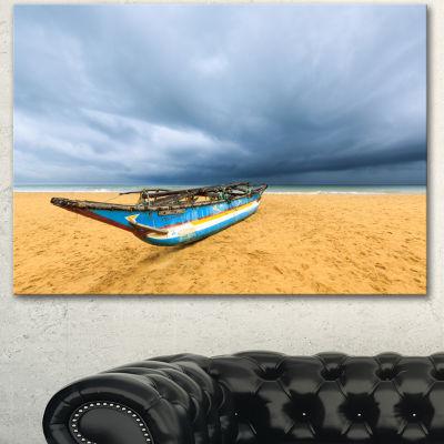 Designart Fishing Boat On Beach With Dark CloudsLarge Seashore Canvas Art Print - 3 Panels