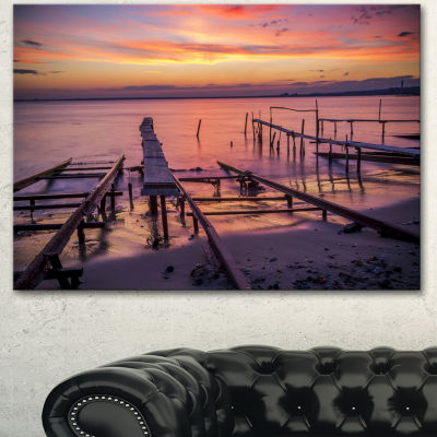 Designart Fishing Pier In Sea At Sunset SeashoreCanvas Art Print - 3 Panels