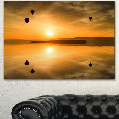 Designart Flying Balloons And Reflection Large Seashore Canvas Art Print