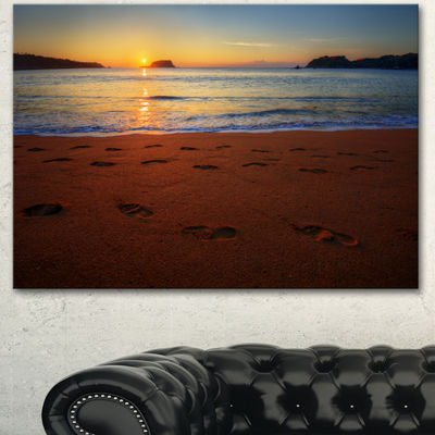 Designart Foot Printed Sandy Ocean Beach SeashoreCanvas Art Print