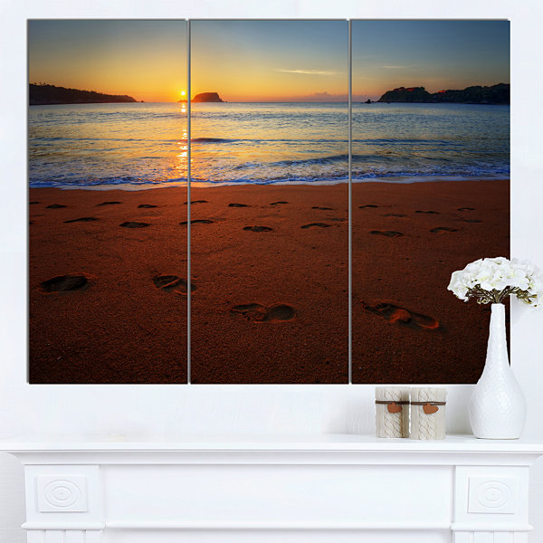 Designart Foot Printed Sandy Ocean Beach SeashoreCanvas Art Print - 3 Panels
