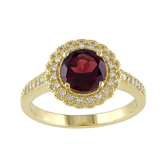 Genuine Garnet and 1/7 CT. T.W. Diamond Ring