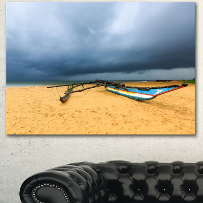Designart Beach With Dark Clouds Above Ocean LargeSeashore Canvas Art Print