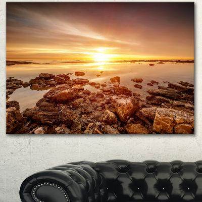 Designart Beautiful Sunset Over Rocky Beach LargeSeashore Canvas Art Print