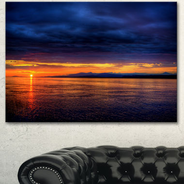Designart Blue Cloudy Sky And Setting Sun SeashorePhoto Canvas Art Print