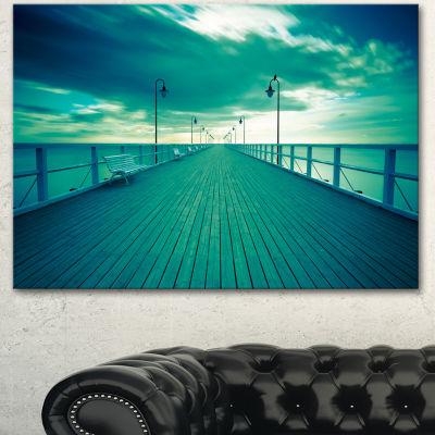 Designart Blue Seascape With Wooden Pier Bridge Canvas Art Print