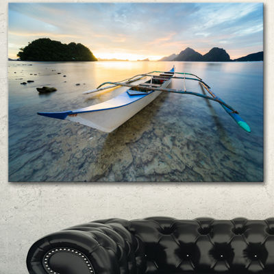 Designart Boat Docked At Beautiful Sunset SeashoreCanvas Art Print 3 Panels