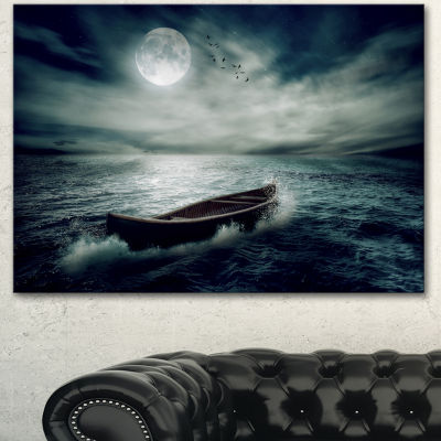 Designart Boat Drifting Away After Storm SeashoreCanvas Art Print