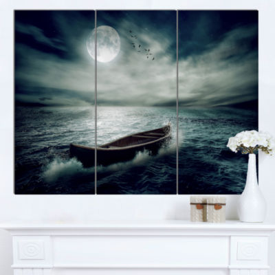 Designart Boat Drifting Away After Storm SeashoreCanvas Art Print  3 Panels