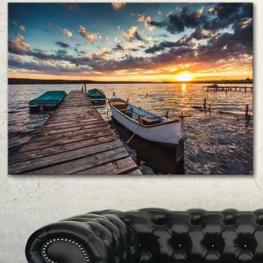 Designart Boats And Jetty Under Dramatic Sky Modern Canvas Art Print