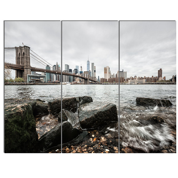Designart Brooklyn Bridge With Rocks On Shore Large Cityscape Canvas Art Print 3 Panels