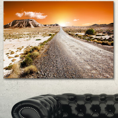 Designart Sunset Desert With Pebble Road LandscapeCanvas Art Print