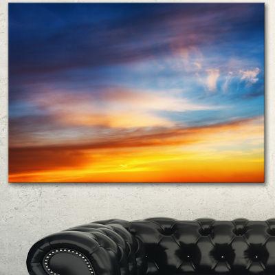 Designart Sunset Dramatic Yellow Sky Clouds Seashore Canvas Art Print - 3 Panels