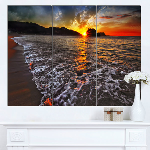 Designart Setting Sun And White Waves Seashore Photo Canvas Art Print - 3 Panels