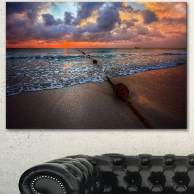 Designart Reddish Sunset Over Clear Beach SeashoreCanvas Art Print - 3 Panels