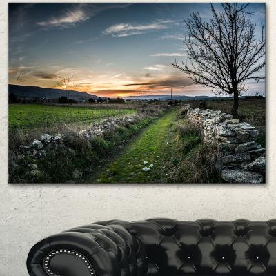 Designart Rocky Fences In Green Grassland Extra Large Landscape Canvas Art Print - 3 Panels