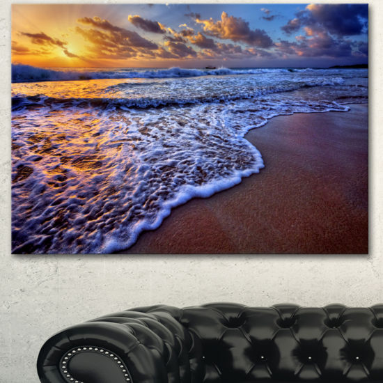 Designart Sunset Over Blue Sea Waves Seashore Canvas Art Print