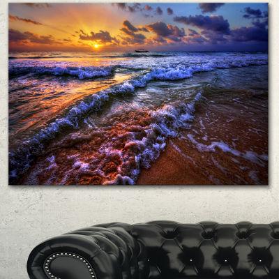 Designart Sunset Over Blue Tinged Waves SeashorePhoto Canvas Art Print - 3 Panels