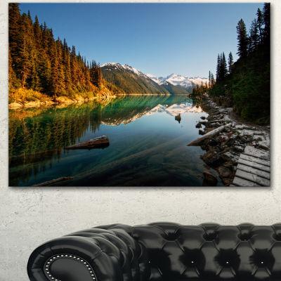 Designart Snowy Path Along Mountain Lake LandscapeCanvas Art Print